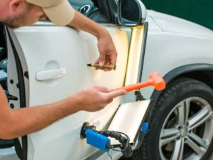 4 surprising ways to get rid of dents in your car